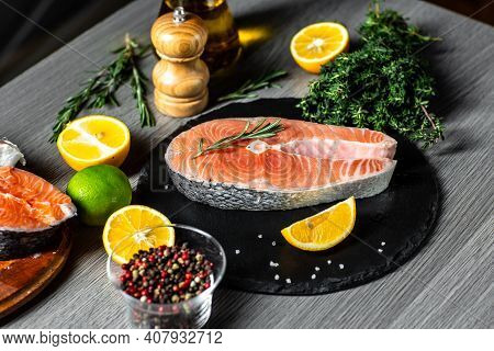 Fresh Salmon And Ingredient. Marinating Salmon Fish, Adds Herbs, Seasoning To Fish Salmon Steak Raw
