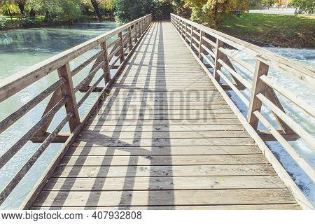 Wooden Footbridge Over The Pivka River In Slovenia