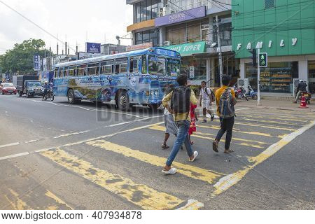 Anuradhapura, Sri Lanka - February 05, 2020: Pedestrians Cross The Street On A Pedestrian Crossing