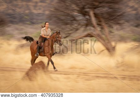 Slow Pan Of Brunette Riding Along Track