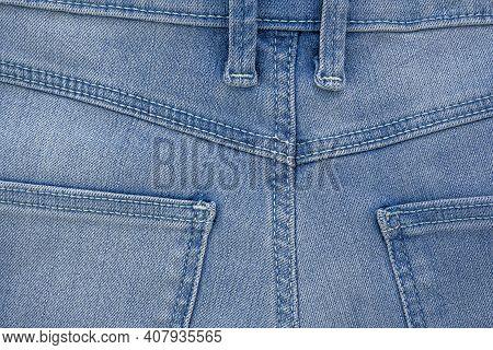 Backside Denim Blue Jeans Pocket Closeup. Denim Jeans Texture. Blue Jeans Texture With Pocket For An