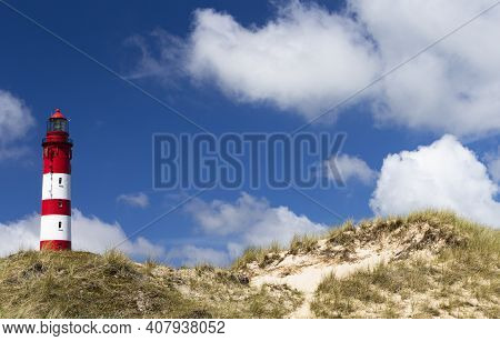 The Photo Shows The Amrum Lighthouse In The Dunes With Beautiful Sky