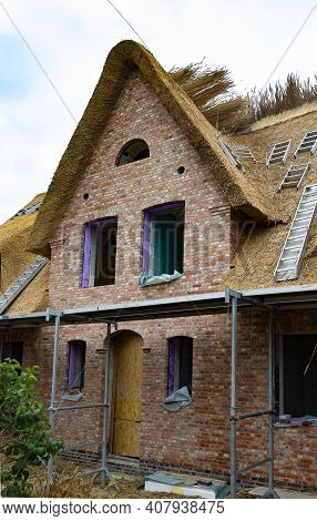 The Photo Shows A Frisian House Under Construction With Thatched Roof