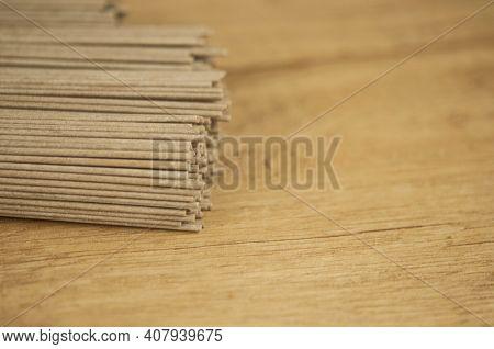soba - buckwheat noodles (raw buckwheat noodles). soba noodles. food background