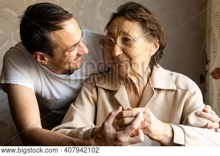 A Very Old Woman And An Adult Grandson