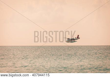 South Ari Atoll, Dhidhoofinolhu, Maldives - December 15 2019: Maldives Airline Seaplane Landing  Nea
