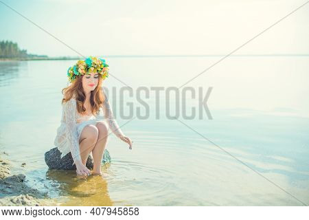 Woman In Lace White Dress In The Water. Art Woman With Wreath On Her Head In River. Wet Witch Girl I