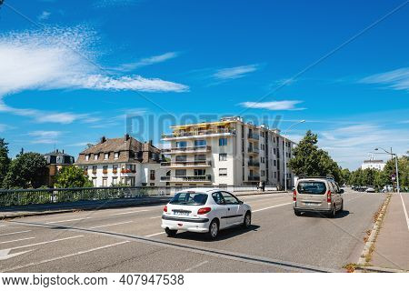 Strasbourg, France - Jul 29, 2017: Tow Cars On The Almost Empty French Street In Strasbourg Crossing