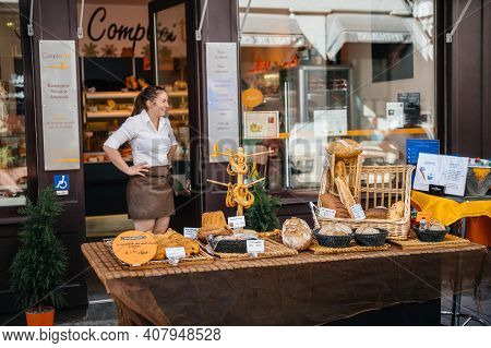 Strasbourg, France - July 29, 2017: Happy Smiling Woman In Front Of Her Stall Selling Multiple Baker