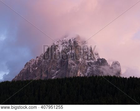 Langkofel During Sundown Seen From La Selva In Val Gardena. The Sassolungo, Lang Kofel Covered In Sn