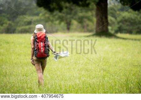 Tourism And Traveler Woman Backpack Travel And Explore Adventure In Nature. Asian People Holding Map