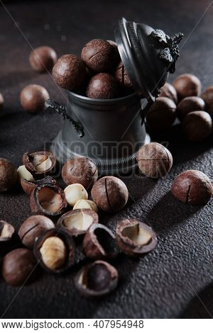 Macadamia Nuts In A Pewter Vase. Vintage Tableware. Large Amounts Of Macadamia Nuts. An Expensive An