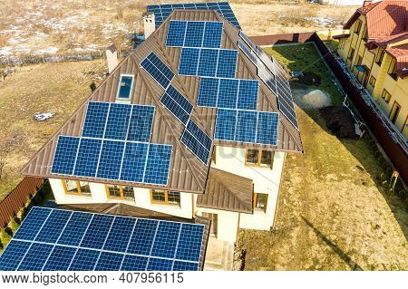 Aerial Top View Of New Modern Residential House Cottage With Blue Shiny Solar Photo Voltaic Panels S