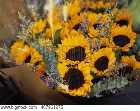 Yellow Sunflower, Statice, Sea Lavender, Marsh Rosemary, Brown And Dark Blue Color A Bouquet Of Flow