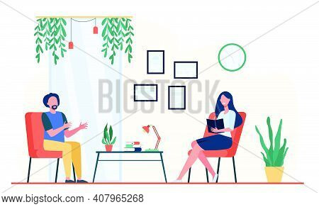 Man Talking To Therapist In Her Office. Patient Sitting In Armchair And Speaking While Positive Doct