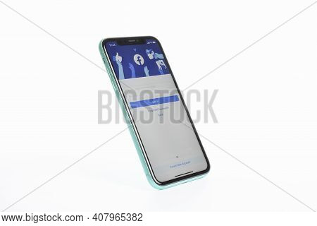 Mykolaiv, Ukraine - July 9, 2020: Iphone 11 With Facebook App On Screen Against White Background