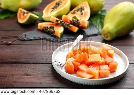 Diced Fresh Ripe Papaya On Wooden Table
