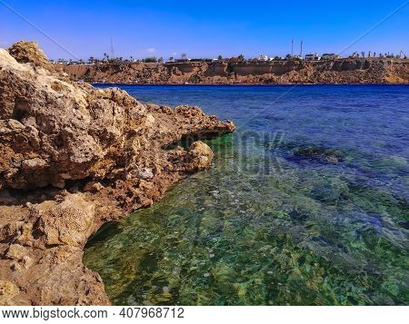 Wild Beach At The Exit From Sharm El Maya Bay In Sharm El Sheikh (egypt). Sandstone Rocks On The Sho