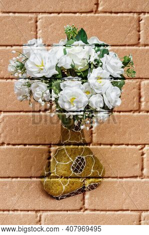 White Roses, Artificial Flowers Of Fabric On A Blurred Copper-coloured Background, In A Decorative V