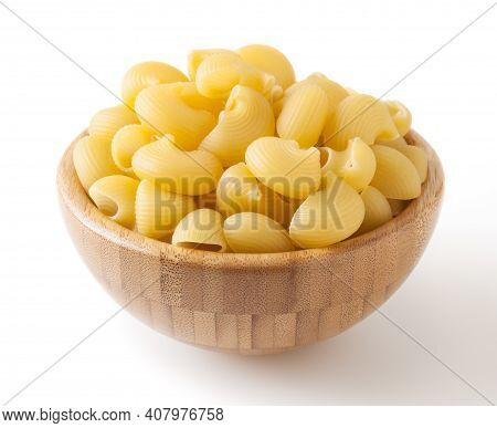 Uncooked Pipe Rigate Pasta In Wooden Bowl Isolated On White Background