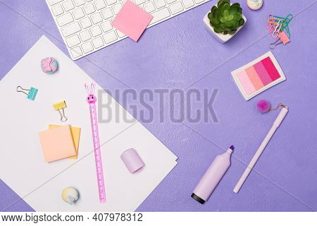 Summer Bright Vivd Flat Lay Workspace. Mess Of Stationary And Keyboard On Bright Violet Purple Backg