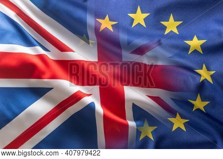 Eu And Uk Flag Blowing In The Wind.