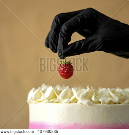 Red Passion In A Black Hand. Dessert For Gay. Sweet Strawberry. Lgbt Style Expression Of Love. Lgbt