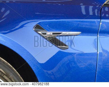Kazakhstan, Ust-kamenogorsk, June 26, 2020: Bmw M5 (f90). Blue Bmw On A Car Carrier Trailer
