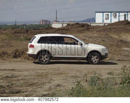 Kazakhstan, Ust-kamenogorsk, July 7, 2020: White Volkswagen Touareg. Construction Site