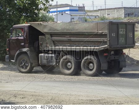 Kazakhstan, Ust-kamenogorsk, July 21, 2020: Kamaz 5511. Old Soviet Dump Truck. City Street