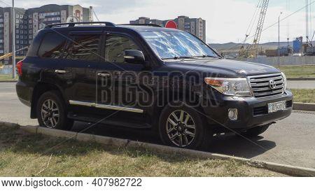 Kazakhstan, Ust-kamenogorsk, July 21, 2020: Luxury Offroad Vehicle Toyota Land Cruiser 200. Black Ja