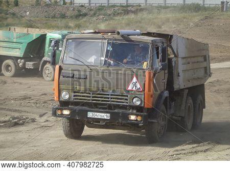 Kazakhstan, Ust-kamenogorsk, July 7, 2020: Kamaz 5511. Old Soviet Dump Truck. Construction Site