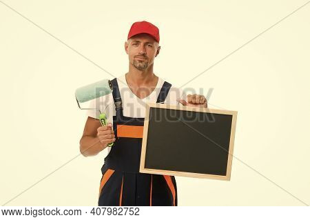 Training That Transforms Beginner Into Skilled Professional. Painter Hold Blackboard And Paint Rolle