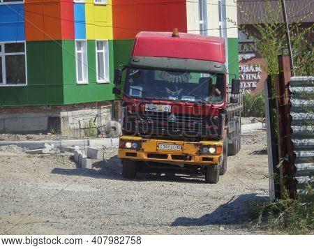 Kazakhstan, Ust-kamenogorsk, August 8, 2020: Howo Cnhtc, Chinese Lorry. Semi-trailer Truck. Construc