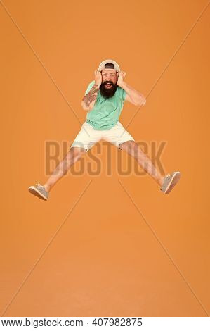 Dj Cheerful Guy. Amazing Stereo Sound. Summer Party. Man Listen Music Wireless Headphones. Bearded G