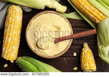 Corn Flour In Bowl And Fresh Cobs On Wooden Table, Flat Lay