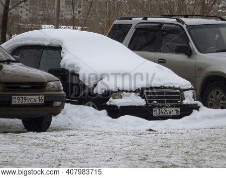 Kazakhstan, Ust-kamenogorsk, January 28, 2020: Mercedes-benz W202. Old German Car. Car Under The Sno
