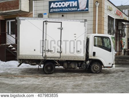 Kazakhstan, Ust-kamenogorsk, February 6, 2020: Food Delivery To The Grocery Store. White Truck. Deli