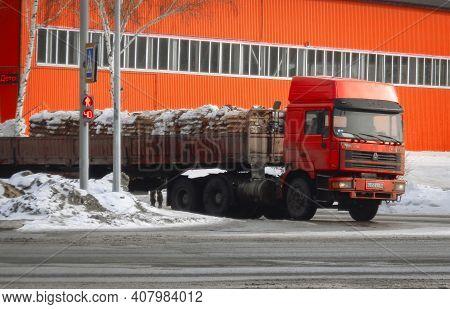 Kazakhstan, Ust-kamenogorsk, February 6, 2020: Howo Sinotruck Semi-trailer Truck In The City Street.