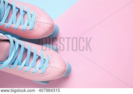 Pair Of Stylish Quad Roller Skates On Color Background, Flat Lay. Space For Text