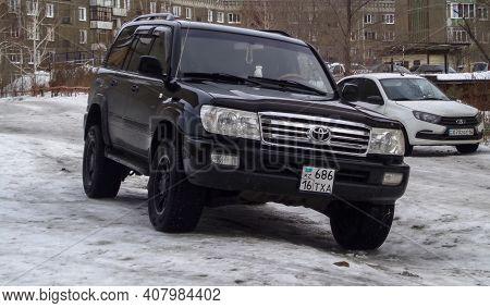 Kazakhstan, Ust-kamenogorsk,  February 8, 2020: Luxury Offroad Vehicle Toyota Land Cruiser 100. Blac