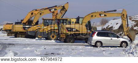 Kazakhstan, Ust-kamenogorsk, February 29, 2020: Construction Machinery Parking. Excavator, Wheel Loa
