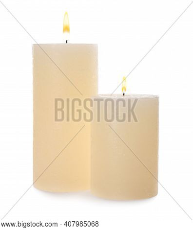 Two Pillar Wax Candles Isolated On White