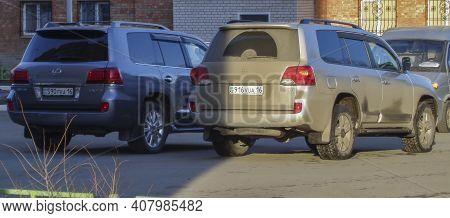 Kazakhstan, Ust-kamenogorsk, March 27, 2020: Toyota Land Cruiser 200 And Lexus Lx570
