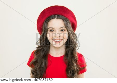 French Style Inspiration. Adorable Small Girl Wearing Red Beret In Fashion Style. Little Cute Child