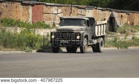 Kazakhstan, Ust-kamenogorsk, June 2, 2020: Old Soviet Truck Zil 130. Dumper. Green Retro Truck