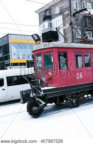 A Special Tram For Cleaning Snow On Rails. A Retro Tram Removes A Layer Of Snow From The Rails With