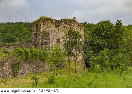 Scenic Ruins Of Medieval Zoloty Potik Castle Outdoor At Summer Day On Green Forest Background. Destr