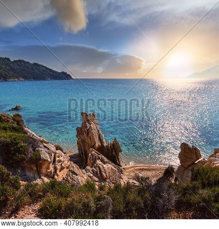 Sunset Summer Sandy Beach And Rocky Coast Near Platanitsi Beach, Sithonia Peninsula, Chalcidice, Gre