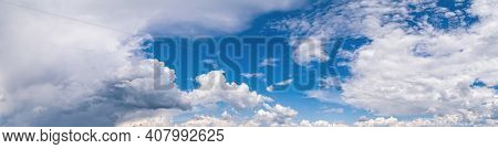 Fuffy Clouds In Blue Sky. Summer Good Weather Skyscape Background.